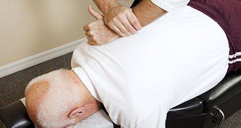 Chiropractors hands doing spinal adjustment