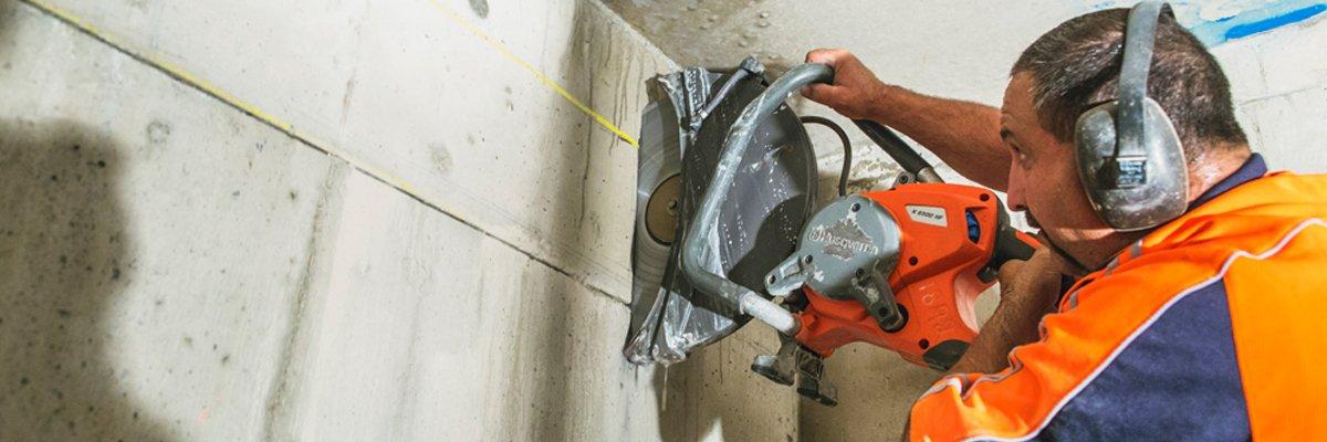 a 1 concrete services professional holding helmet