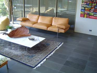living space with dark flooring