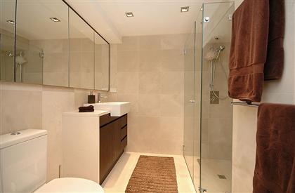 glass shower in warm bathroom