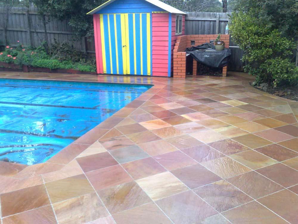 warm tiles surrounding pool