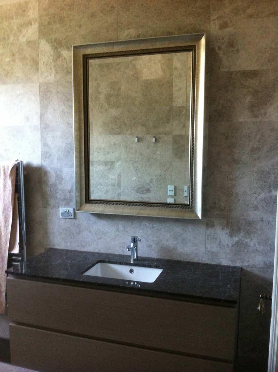 tile surrounding bathroom mirror