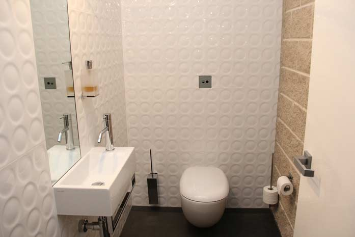 bathroom white textured tile