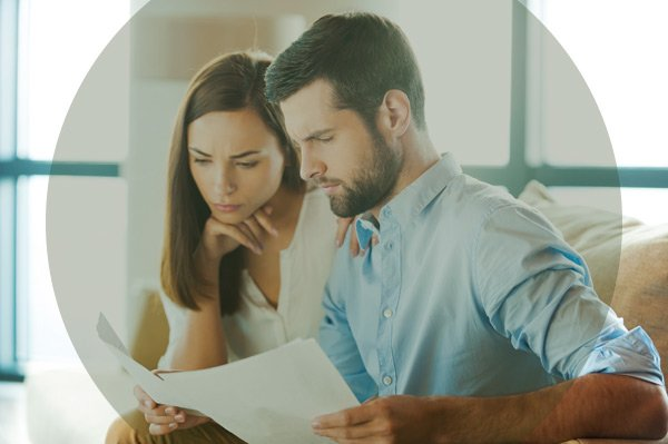 couple looking at financial documents