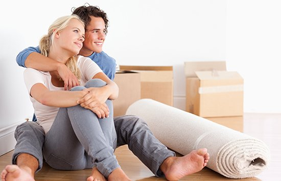 bay removals couple sitting on the floor