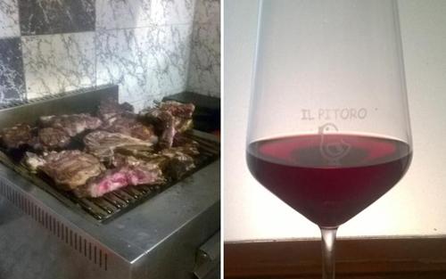 fiorentina alla griglia e bicchiere di vino rosso