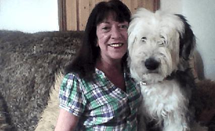 A woman with a big fluffy dog