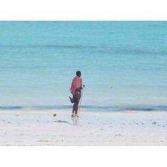 sabbia bianca, mare blu, acqua limpida