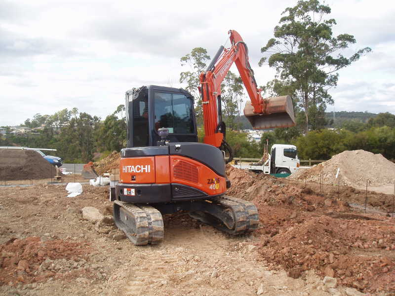 Orange backhoe own by Gold Coast earthmoving companies