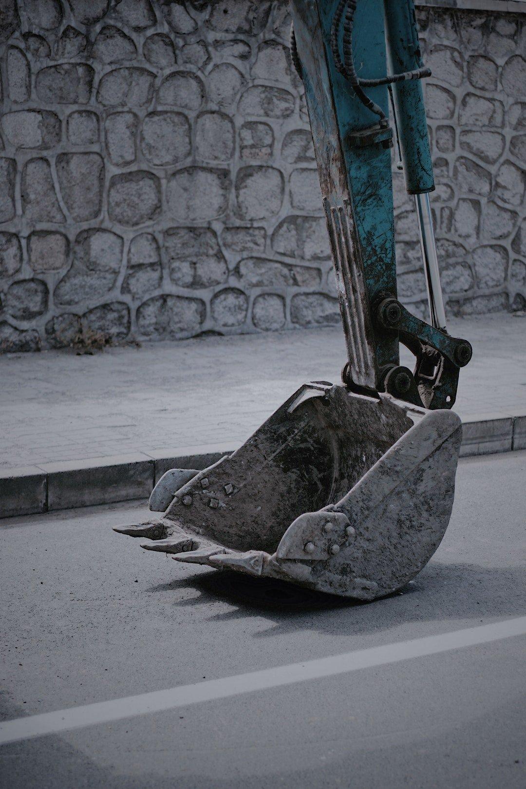 Excavator Equipment by Kuan Fang on unsplash.com for E&R Bobcat & Excavator Services