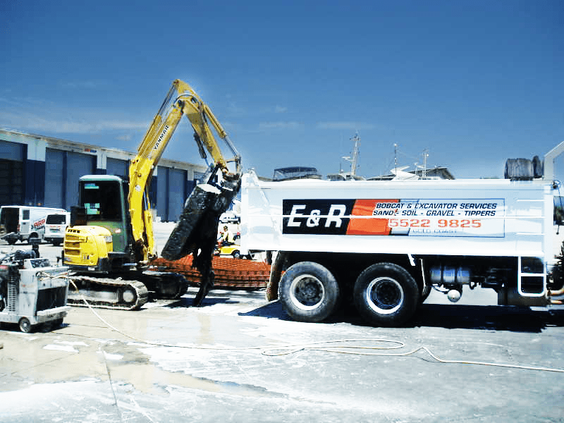Yellow bobcat equipment for hire and E&R dump truck
