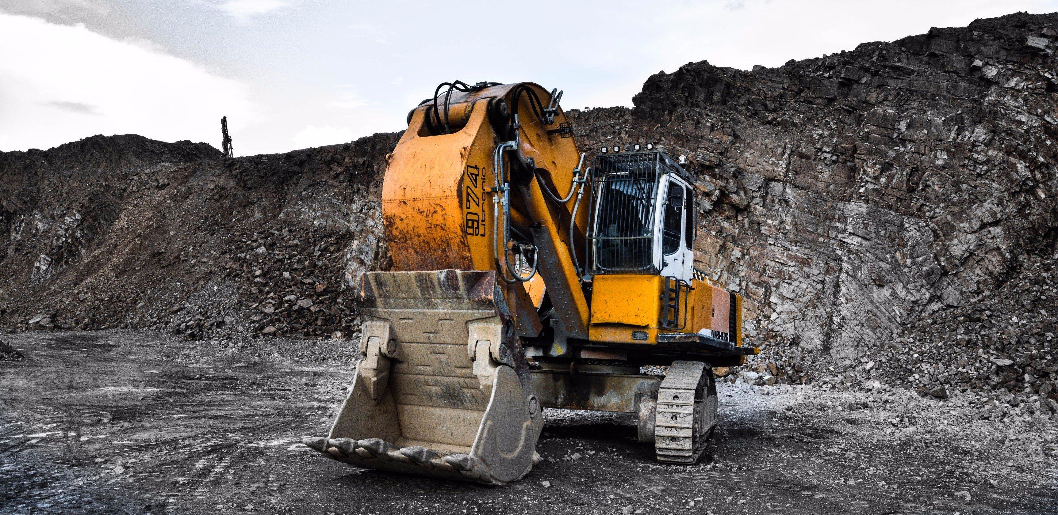 Heavy Excavation Equipment by Jonny Caspari on unsplash.com for E&R Bobcat & Excavator Services