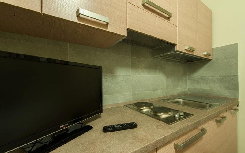 Some of the rooms have kitchen areas