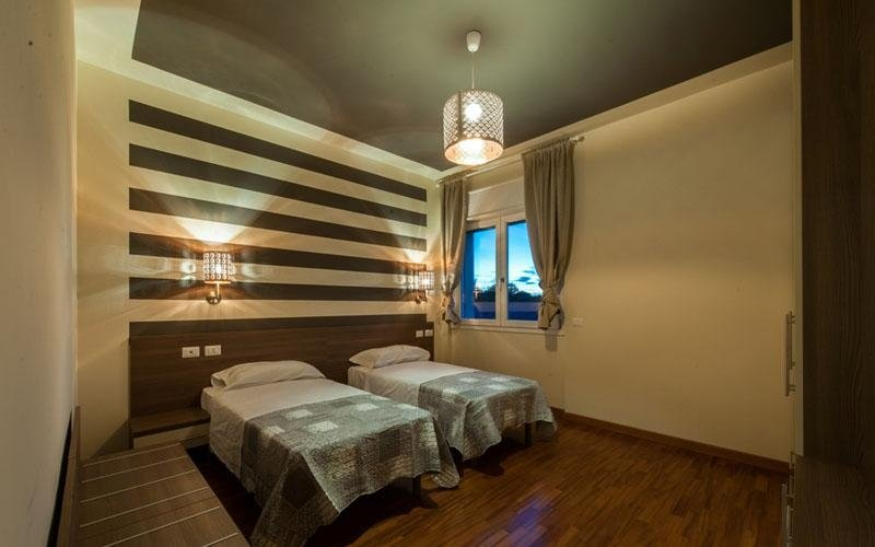 Double hotel room with wooden floor