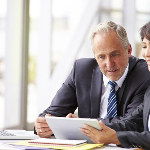 an investment specialist goes over the numbers with a client