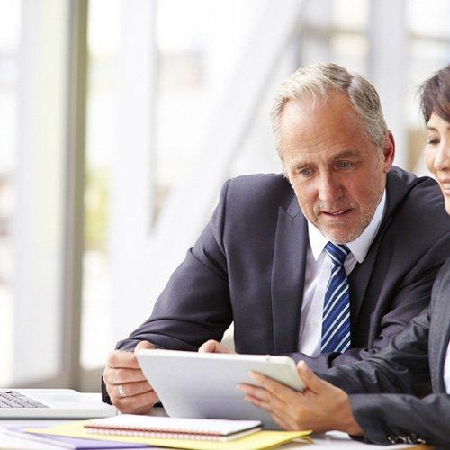 a financial advisor looks over the finances