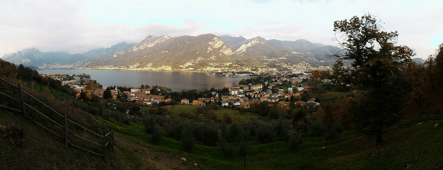 Panoramic view of a lake with mountains-production-Garlate countryside