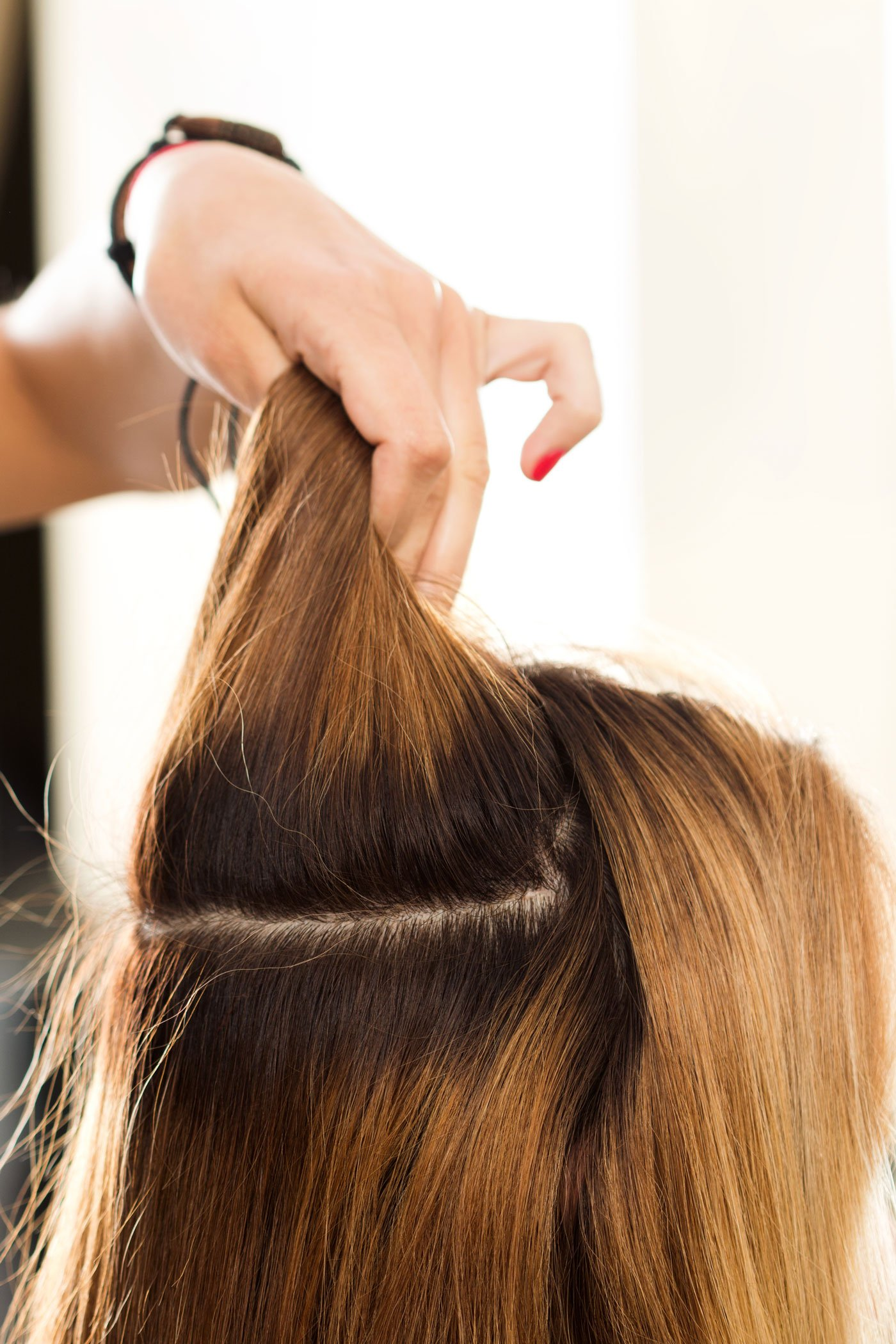 Girl hair holds up for cutting