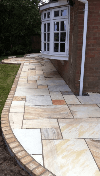 Light buff sandstone and fossil buff block edging to set it off