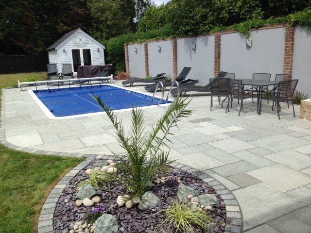 Bradstone patio and planting to frame this swimming pool