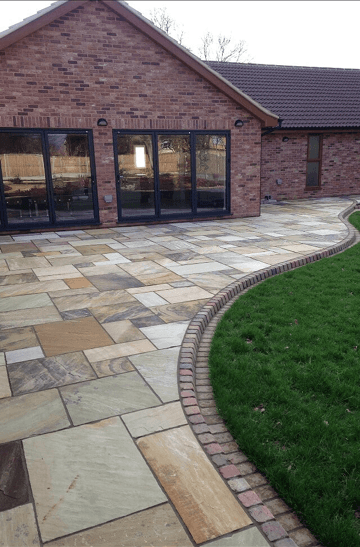 How about more colour with fossil sandstone paving and autumn kerbs