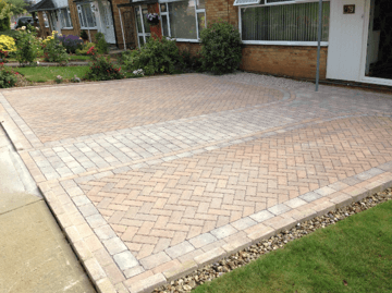 Permeable paving option, mixed tumbled and herringbone blocks