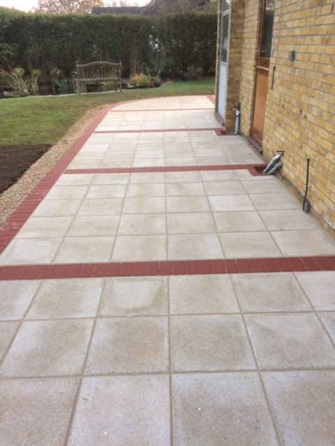 Saxon sand textured paving to link with existing utility paving