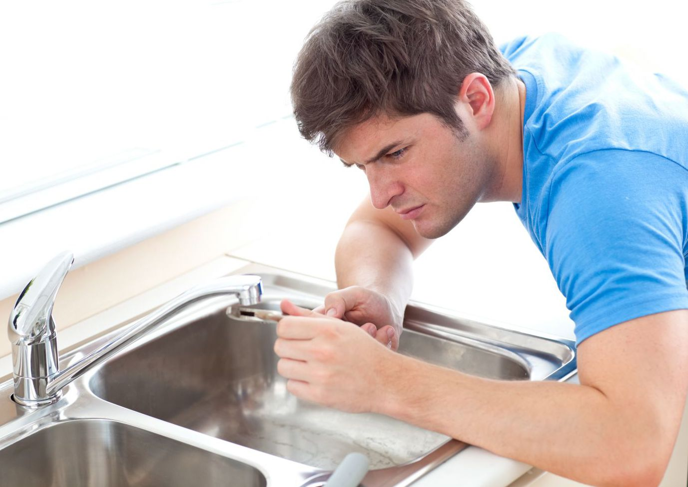 A technician providing plumbing services in Thomasville, NC