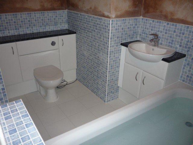 bathroom with alternate tiles