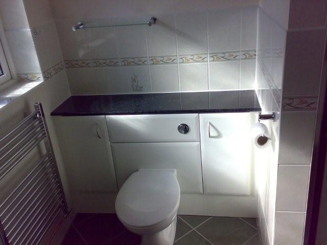 bathroom with cabinets