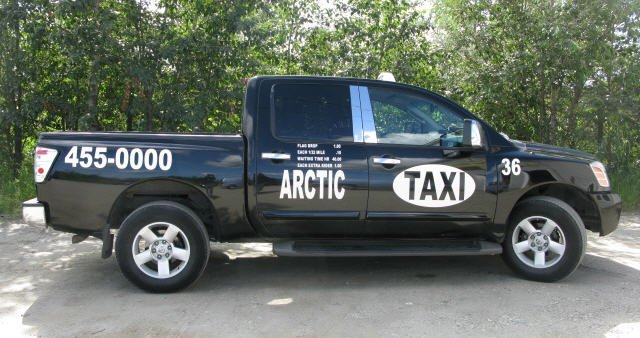 Arctic taxi truck service going to a road in the mountains