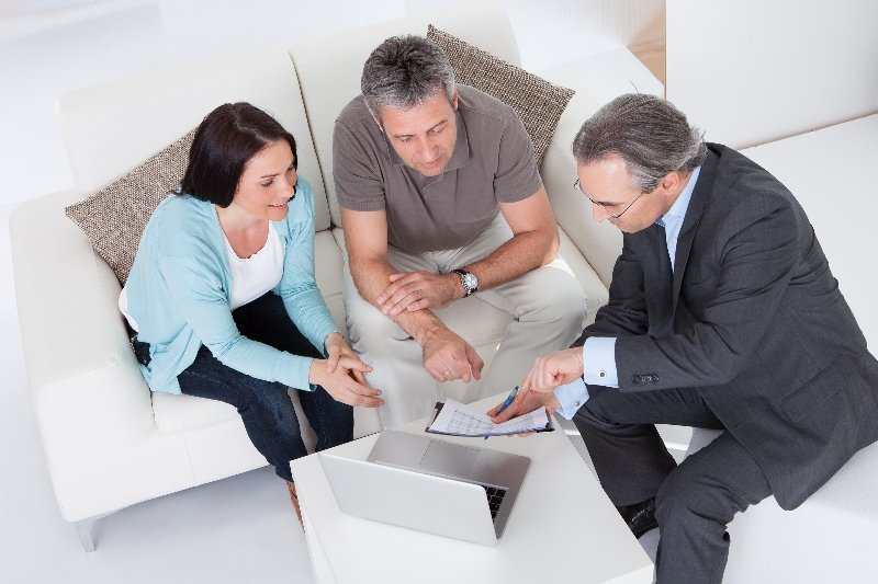 Couple speaking with insurance agent