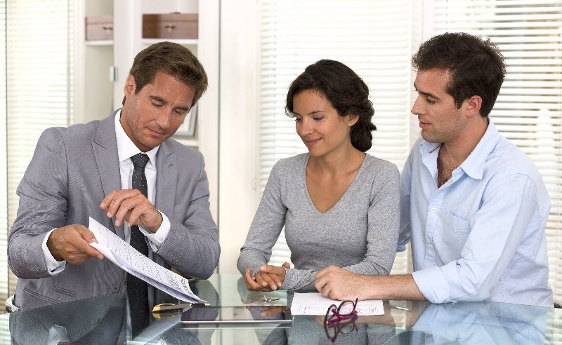 Couple consulting with insurance agent