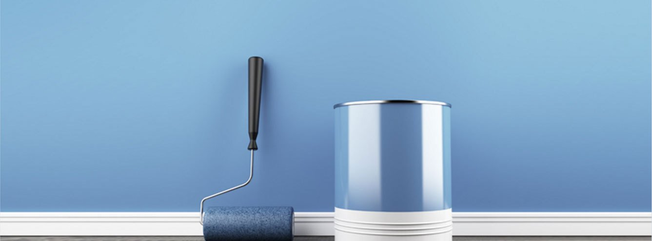 blue paint, a paint roller and a blue wall