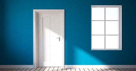teal blue room with white door, floor and paintwork