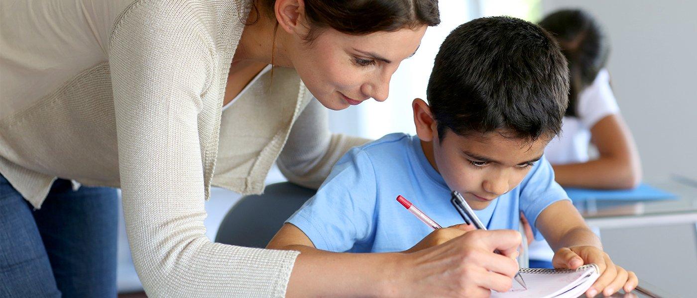 woman teacher and a boy student