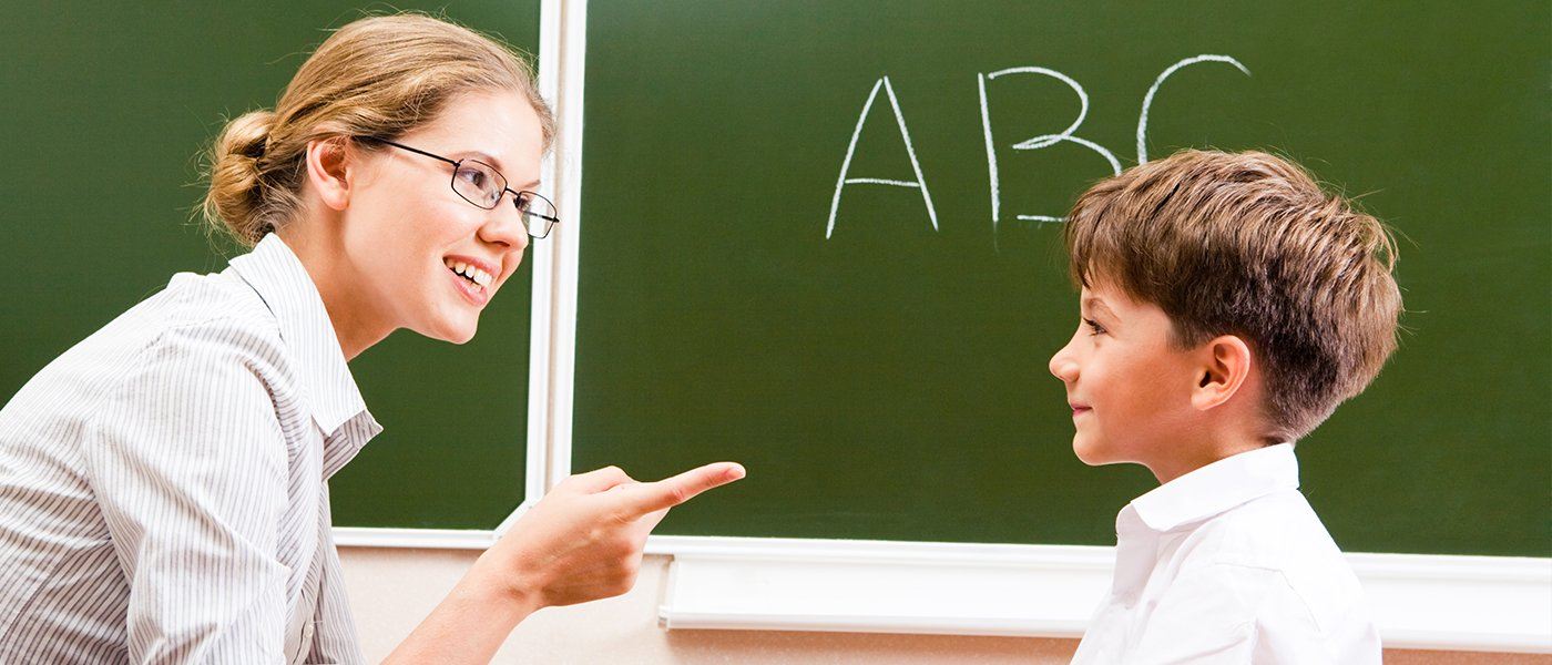 teacher and a student smiling