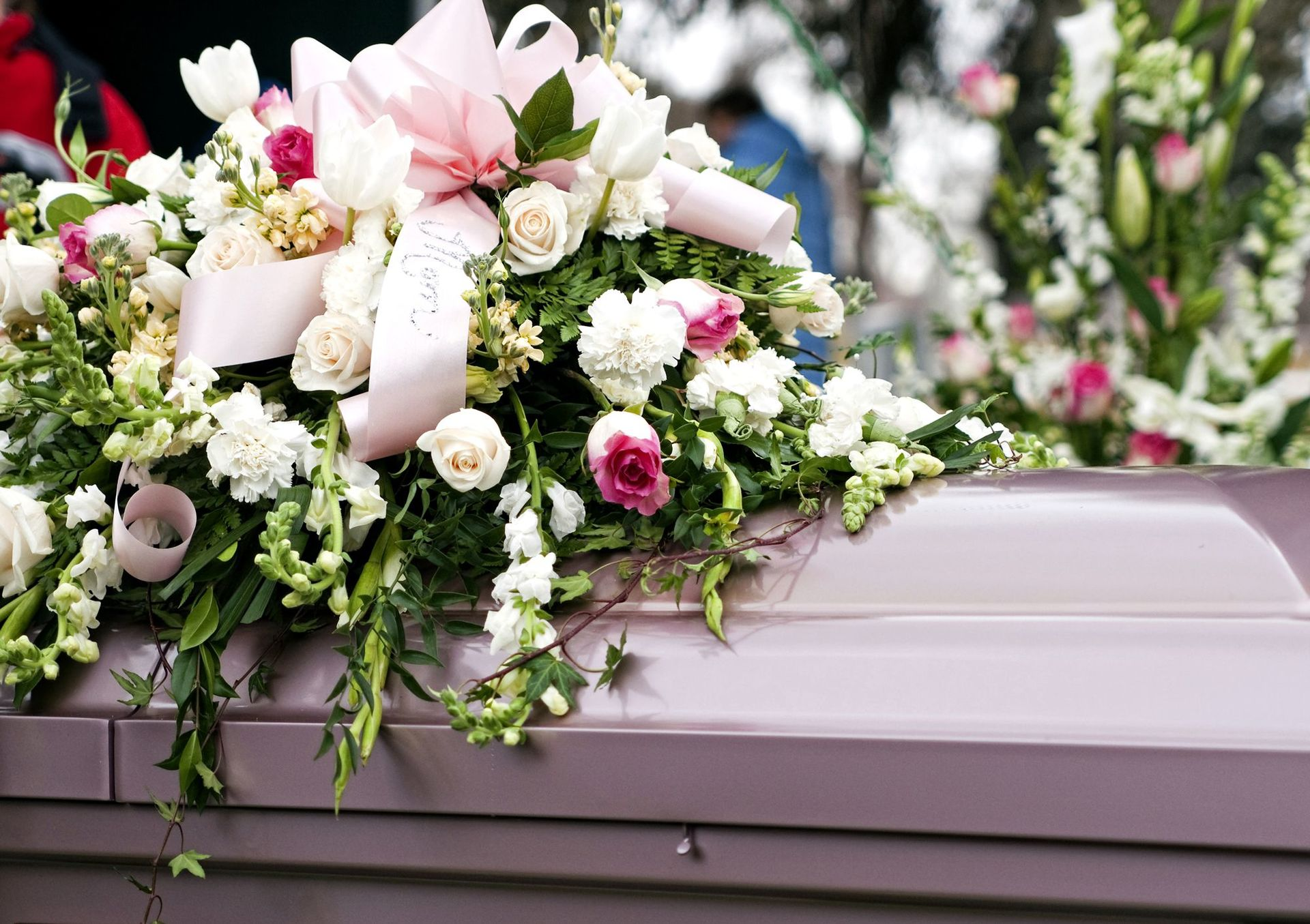 What do families do with flowers after the funeral izmirmasajfo
