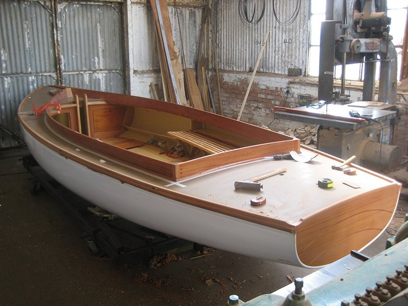 white and brown wooden boat