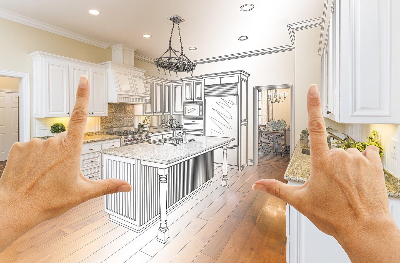 mani che inquadrano una cucina disegnata