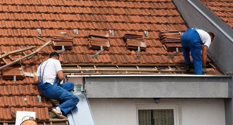 roofers installing roofing