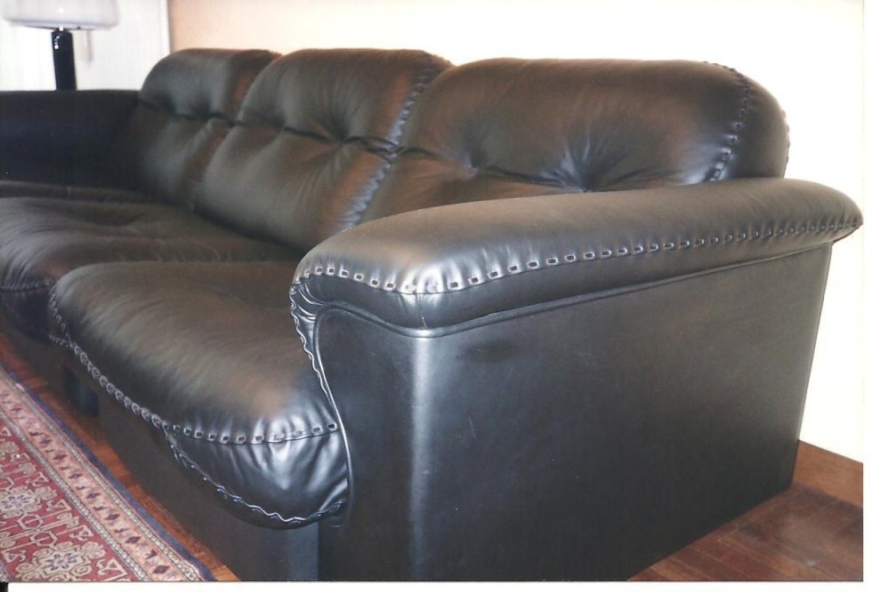 refurbishment of a leather sofa with hand stitching