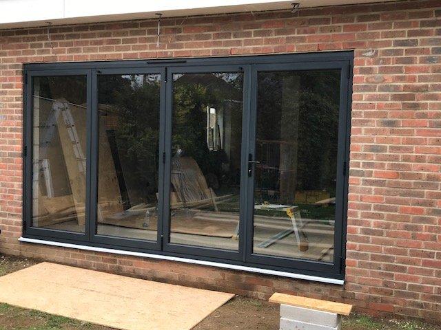 Open black 4paned bifold doors