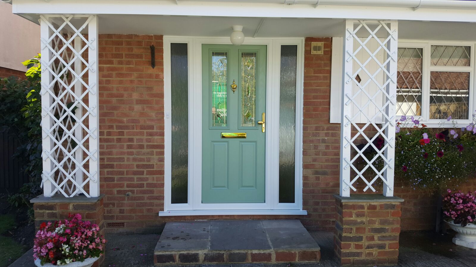 Chartwell Green composite door with gold furniture