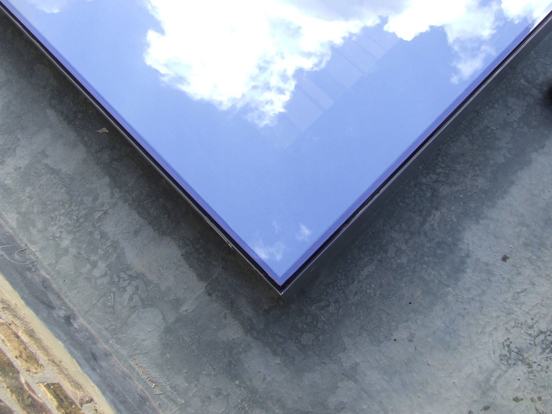 rooflight with reflection of the sky