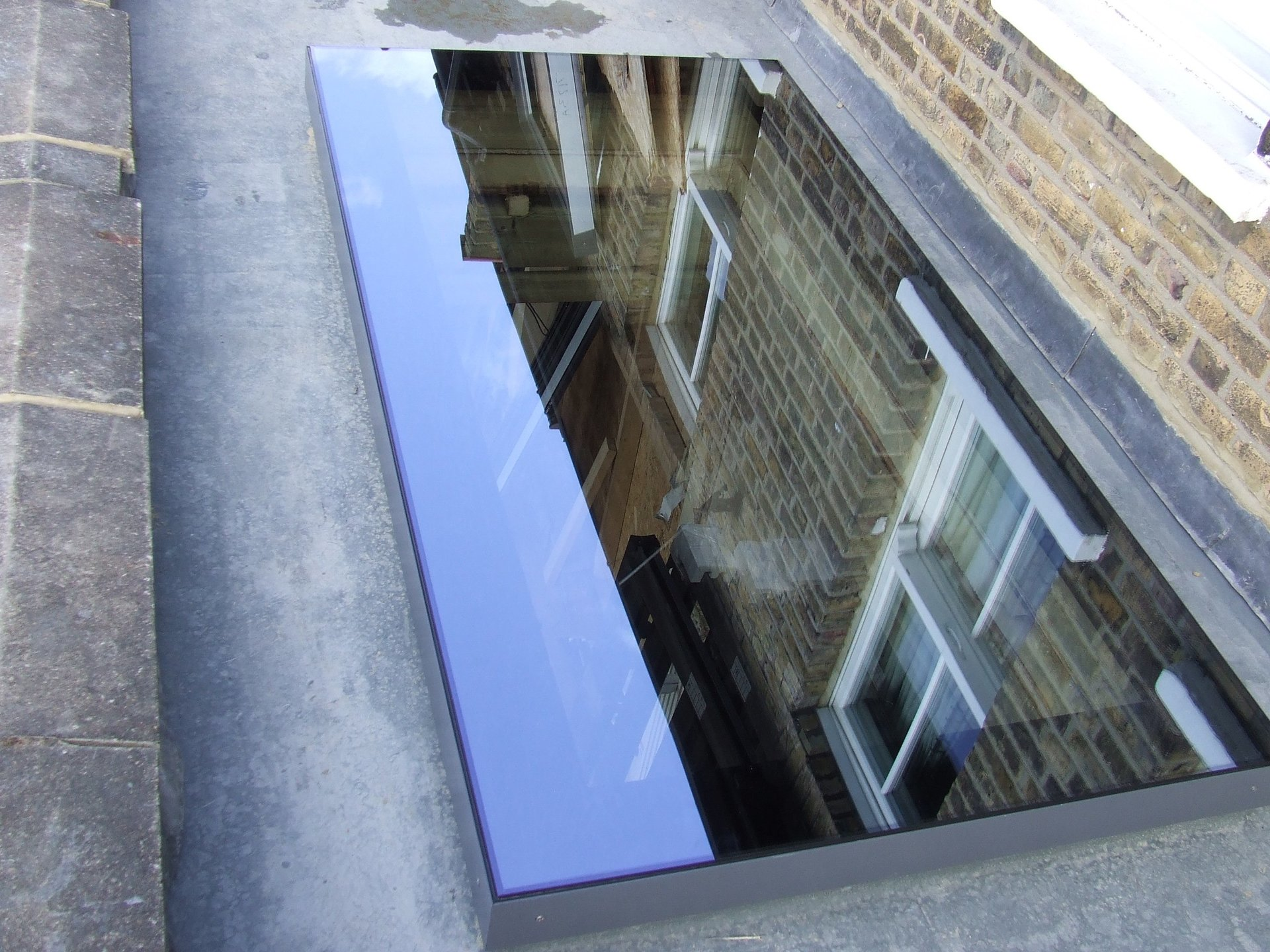 rooflight with reflection of building