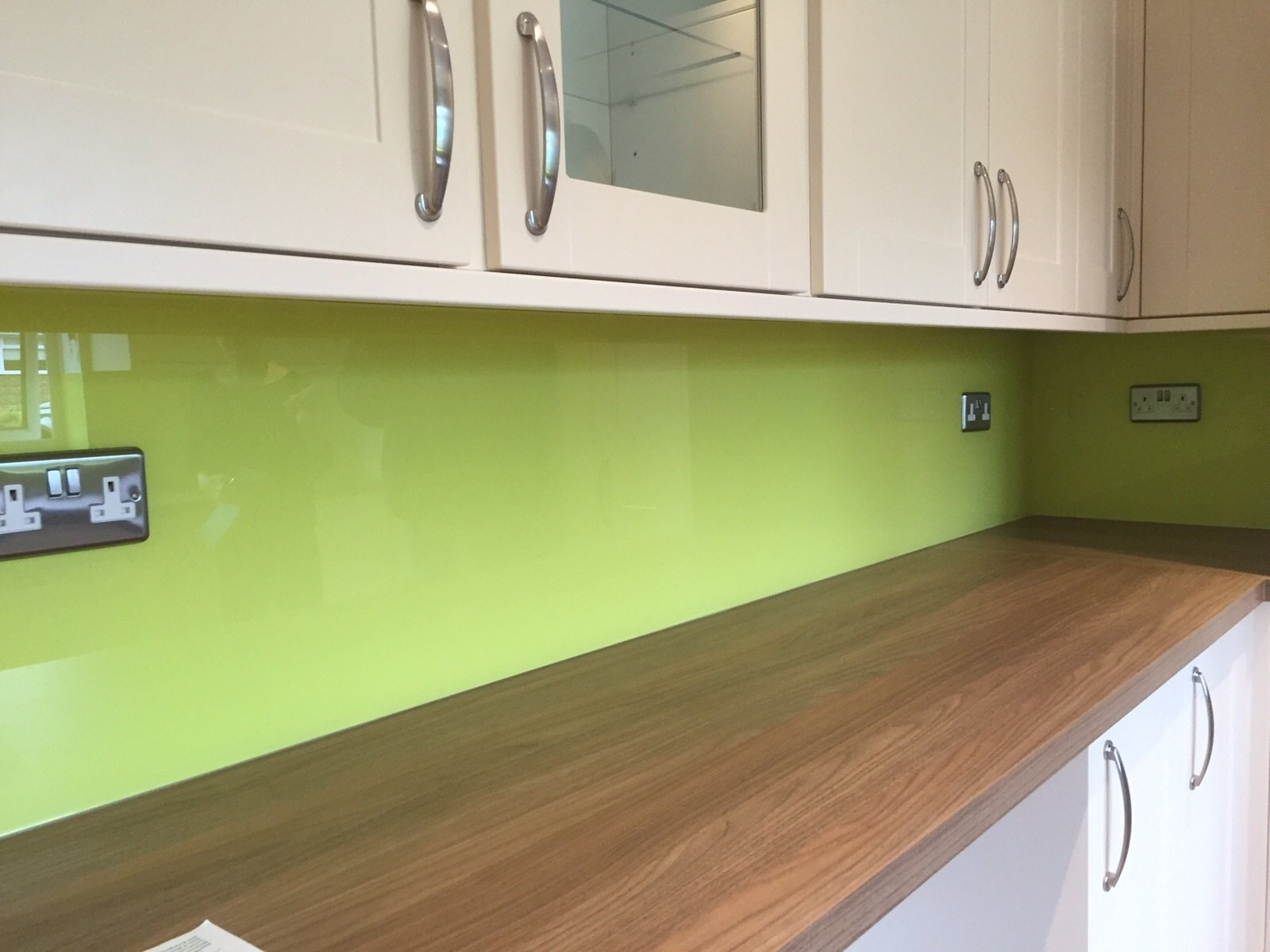 Green glass splashbacks into the corner