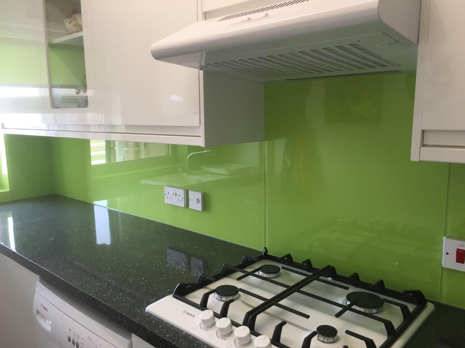 Green kitchen with black worktops