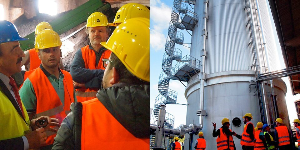 Instructor explains the processes of the municipal waste plant. – In front of the vertical digester of the municipal food-waste plant, Leonberg.