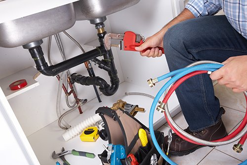 plumbing professional working